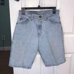 Lea is 550 light blue jean shorts